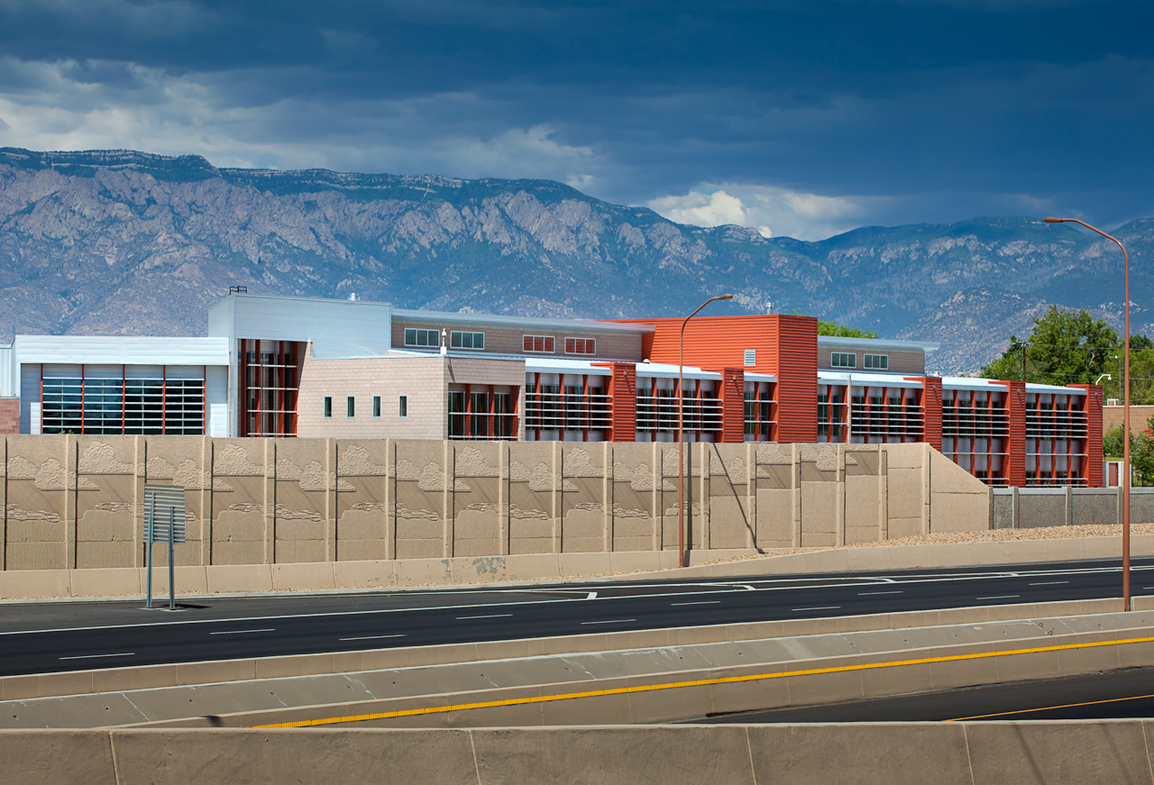 A picture of our building viewed from I-40 with the mountains in the background.
